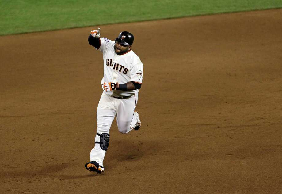San Francisco Giants' Pablo Sandoval reacts after hitting a home run during the fifth inning of Game 1 of baseball's World Series against the Detroit Tigers Wednesday, Oct. 24, 2012, in San Francisco. (AP Photo/Jeff Chiu) Photo: Jeff Chiu, Associated Press / AP