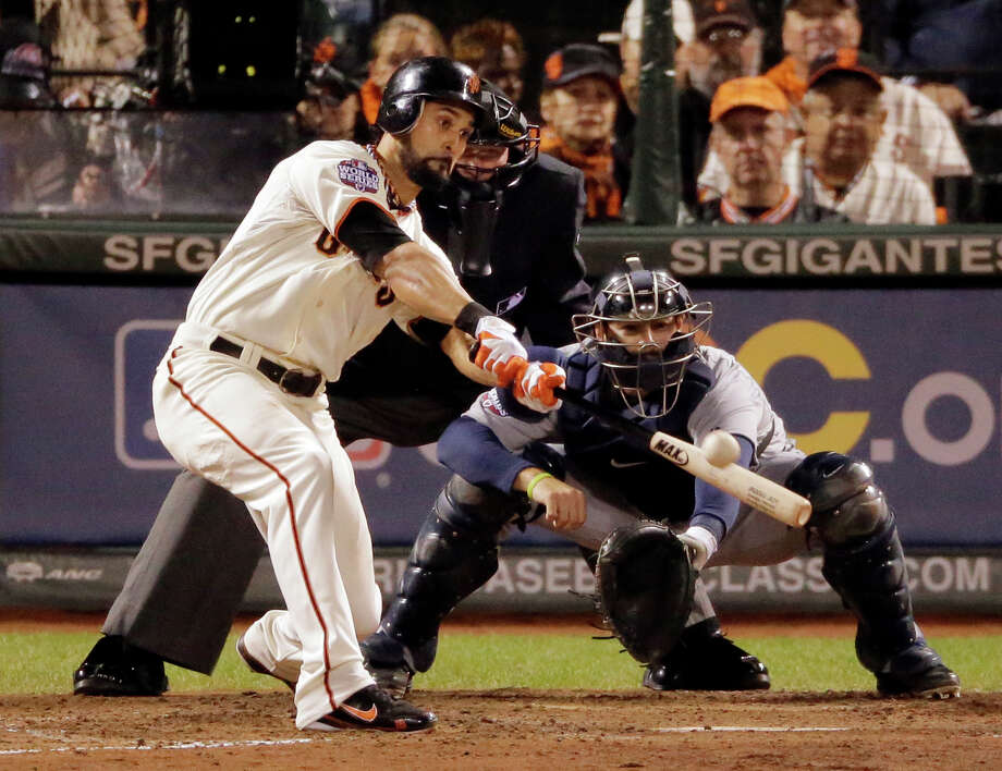 San Francisco Giants' Angel Pagan hits a double in the seventh inning of Game 1 of baseball's World Series, against the Detroit Tigers, Wednesday, Oct. 24, 2012, in San Francisco. (AP Photo/Charlie Riedel) Photo: Charlie Riedel, Associated Press / AP
