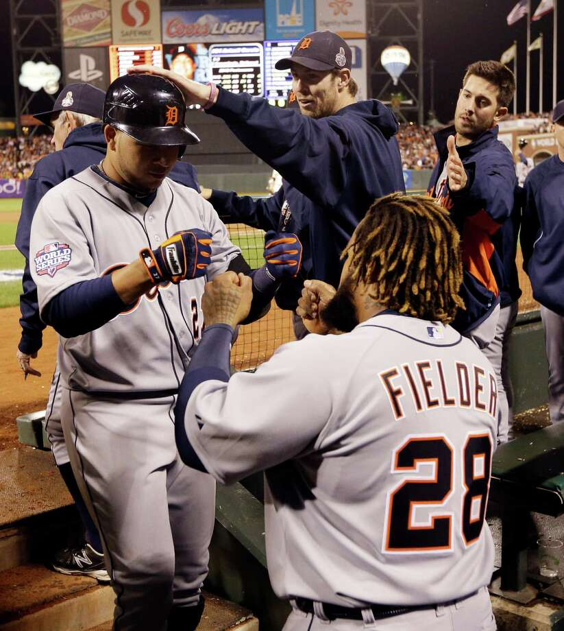 Detroit Tigers' Jhonny Peralta is congratulated in the dugout after hitting a two-run home run during the ninth inning of Game 1 of baseball's World Series against the San Francisco Giants Wednesday, Oct. 24, 2012, in San Francisco. (AP Photo/David J. Phillip) Photo: David J. Phillip, Associated Press / AP