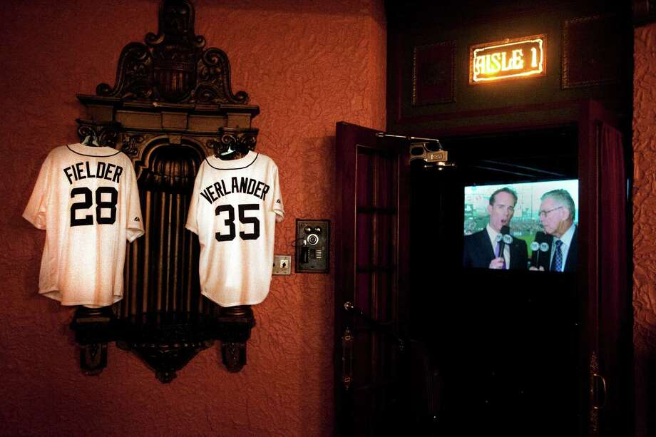Replica jerseys for Detroit Tigers' Prince Fielder (28) and Justin Verlander (35) decorate a wall outside of the Michigan Theater where fans gathered to watch a broadcast of Game 1 of baseball's World Series between the Tigers and the San Francisco Giants, Wednesday, Oct. 24, 2012, in Jackson, Mich. (AP Photo/The Jackson Citizen Patriot, Abbey Oldham) ALL LOCAL TV OUT; LOCAL TV INTERNET OUT Photo: Abbey Oldham, Associated Press / The Jackson Citizen Patriot