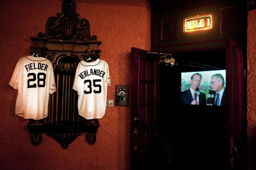 Replica jerseys for Detroit Tigers' Prince Fielder (28) and Justin Verlander (35) decorate a wall ou