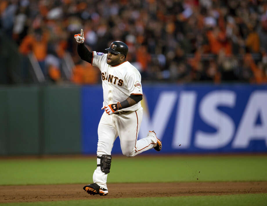 San Francisco Giants' Pablo Sandoval rounds the bases after hitting his second home run against the Detroit Tigers during Game 1 of baseball's World Series, Wednesday, Oct. 24, 2012, in San Francisco. (AP Photo/The Sacramento Bee, Paul Kitagaki Jr.) MAGS OUT; TV OUT (KCRA3, KXTV10, KOVR13, KUVS19, KMAZ31, KTXL40) MANDATORY CREDIT Photo: Paul Kitagaki Jr., Associated Press / The Sacramento Bee