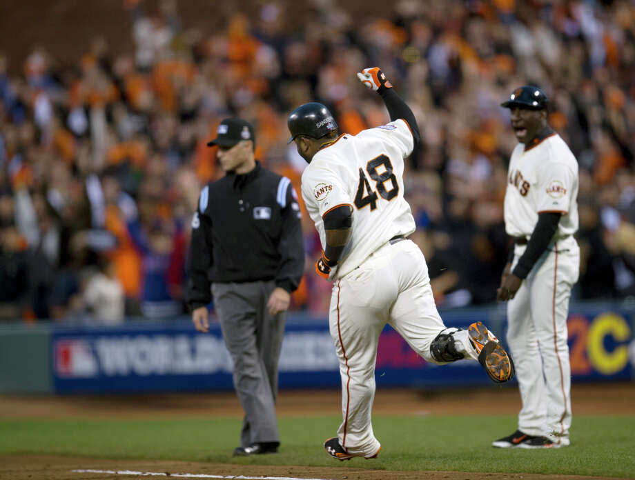 San Francisco Giants' Pablo Sandoval (48) approaches first base after hitting his second home run, as Giants first base coach Roberto Kelly (39) watches during Game 1 of the World Series between the Giants and the Detroit Tigers, Wednesday, Oct. 24, 2012, in San Francisco. (AP Photo/The Sacramento Bee, Paul Kitagaki Jr.) MAGS OUT; TV OUT (KCRA3, KXTV10, KOVR13, KUVS19, KMAZ31, KTXL40) MANDATORY CREDIT Photo: Paul Kitagaki Jr., Associated Press / The Sacramento Bee