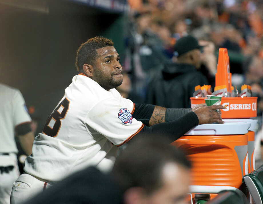 San Francisco Giants' Pablo Sandoval stands in the dugout after hitting his third home run against the Detroit Tigers during Game 1 of baseball's World Series, Wednesday, Oct. 24, 2012, in San Francisco. (AP Photo/The Sacramento Bee, Paul Kitagaki Jr.) MAGS OUT; TV OUT (KCRA3, KXTV10, KOVR13, KUVS19, KMAZ31, KTXL40) MANDATORY CREDIT Photo: Paul Kitagaki Jr., Associated Press / The Sacramento Bee
