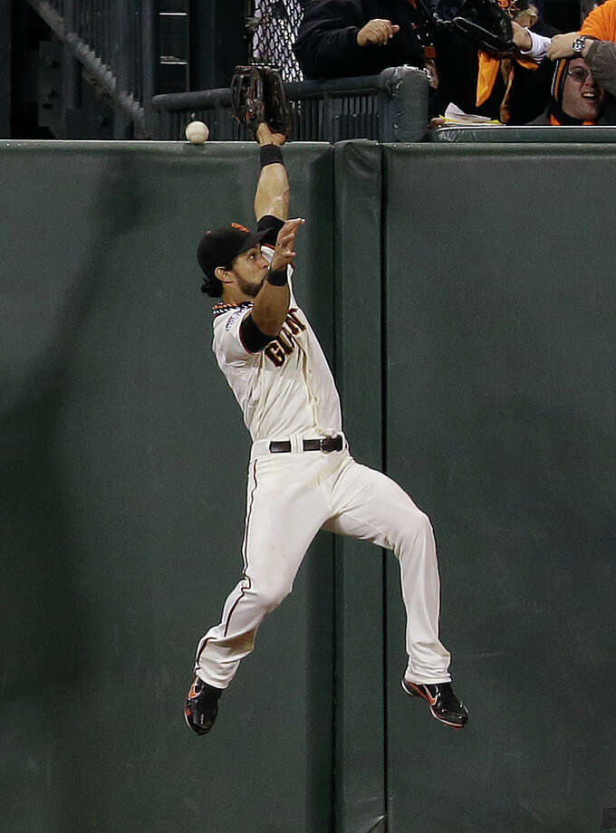 San Francisco Giants' Angel Pagan tries to catch a two-run home run by Detroit Tigers' Jhonny Peralta during the ninth inning of Game 1 of baseball's World Series Wednesday, Oct. 24, 2012, in San Francisco. (AP Photo/Marcio Jose Sanchez) Photo: Marcio Jose Sanchez, Associated Press / AP