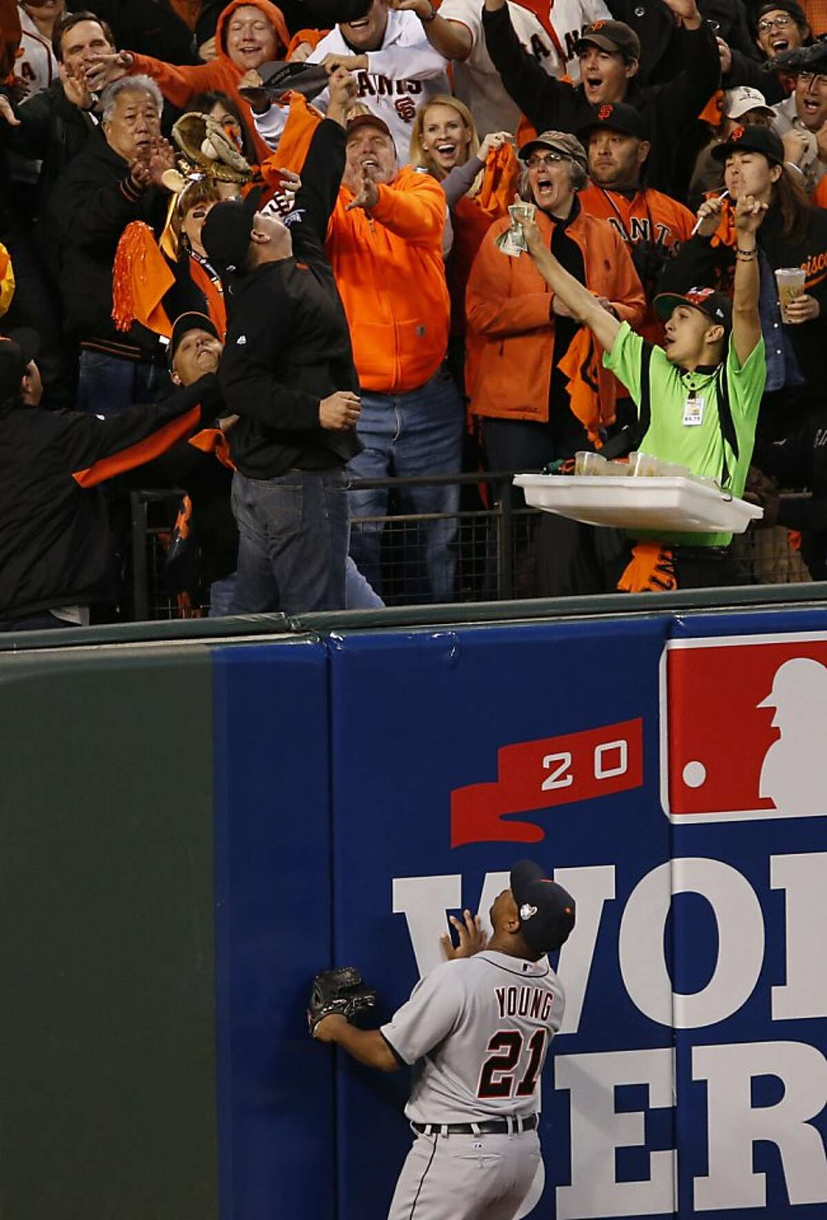 Tigers' left fielder Delmon Young watches Pablo Sandoval's third inning homer during Game 1 of the World Series at AT&T Park on Wednesday, Oct. 24, 2012 in San Francisco, Calif.