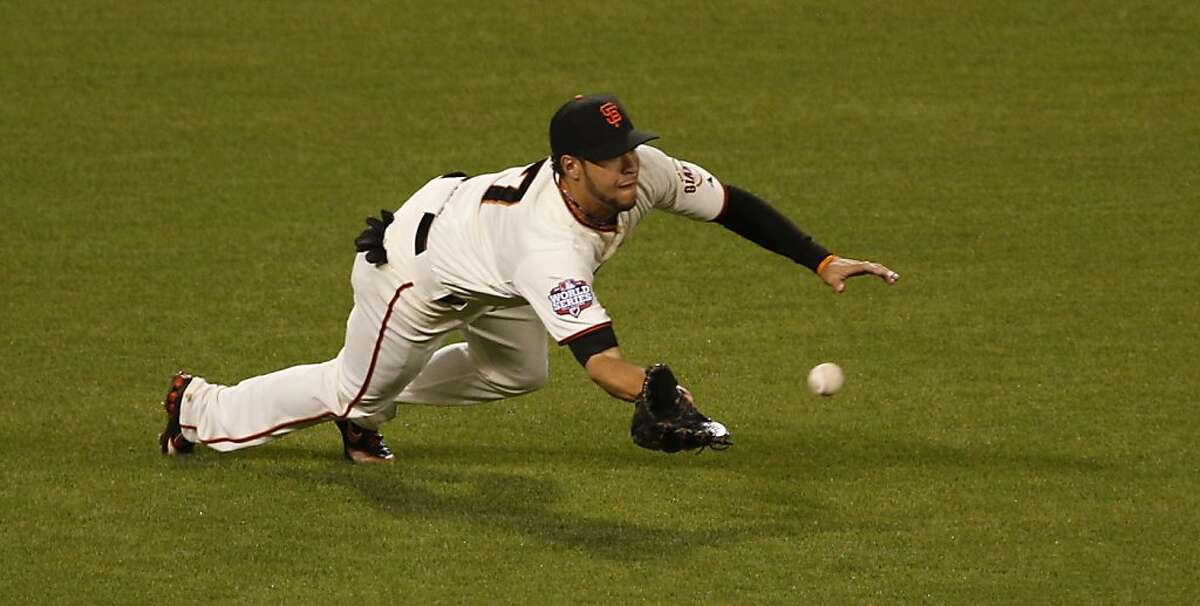 Giants' left fielder Gregor Blanco makes a diving catch in the sixth inning during Game 1 of the World Series at AT&T Park on Wednesday, Oct. 24, 2012 in San Francisco, Calif.