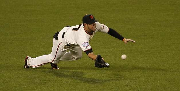 Giants' left fielder Gregor Blanco makes a diving catch in the 6th inning during game 1 of the World Series at AT&T Park on Wednesday, Oct. 24, 2012 in San Francisco, Calif. Photo: Beck Diefenbach, Special To The Chronicle