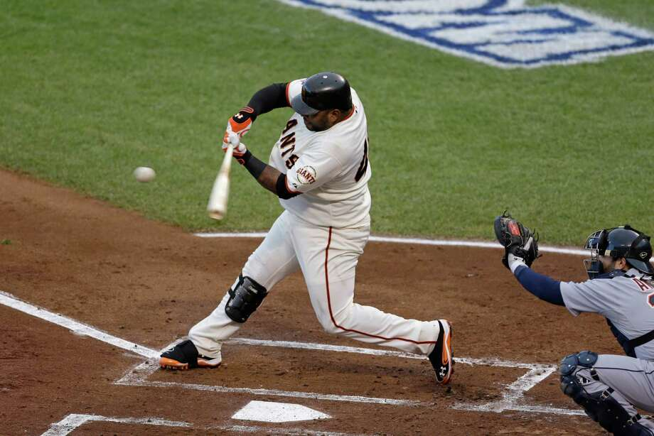 San Francisco Giants' Pablo Sandoval hits a home run during the first inning of Game 1 of baseball's World Series against the Detroit Tigers Wednesday, Oct. 24, 2012, in San Francisco. Detroit Tigers' Alex Avila is the catcher. (AP Photo/Jeff Chiu) Photo: Jeff Chiu