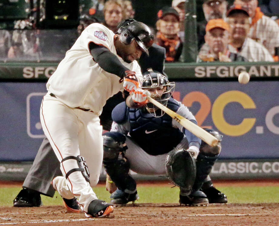 Pablo Sandoval lays lumber on home run No. 3 of his big night in the fifth inning. The slugger went 4-for-4 with four RBIs in leading the Giants to an 8-3 win. Photo: Charlie Riedel / AP