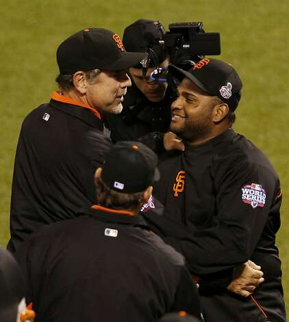 San Francisco Giants manager Bruce Bochy congratulates third baseman Pablo Sandoval after defeating the Detroit Tigers in game one of the World Series on Wednesday, October 24, 2012 in San Francisco, Calif. Photo: Beck Diefenbach, Special To The Chronicle