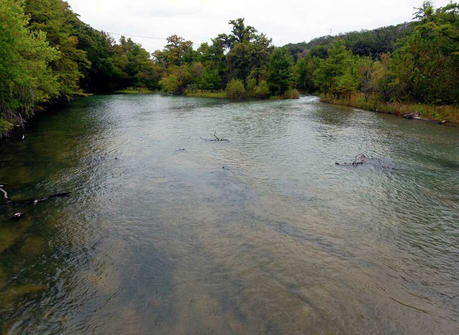 The upper end of Diversion Lake, just below the Medina Lake dam, is seen looking up river Tuesday Oct. 23, 2012 after the BMA began releasing water from the Medina dam. San Antonio Water System requested the release to ensure it has enough water to run its Medina River treatment plant. The Medina dam flood gates had previously been closed since the first week of September to attempt to conserve water. Photo: William Luther, San Antonio Express-News / San Anotnio Express-News