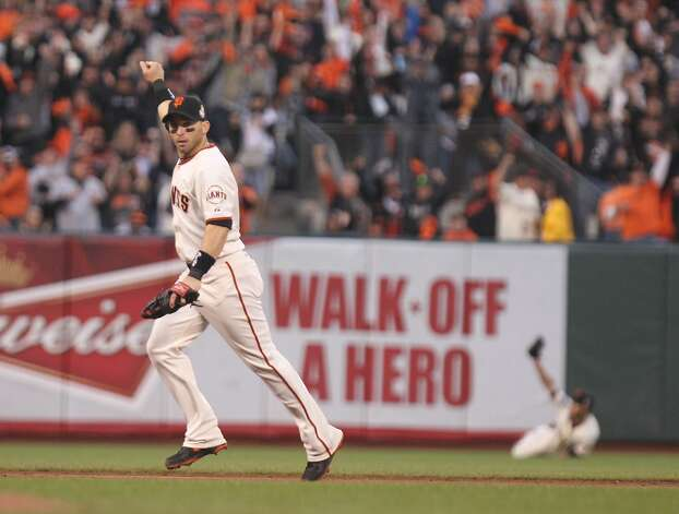 Marco Scutaro celebrates a Gregor Blanco play in the 3rd inning during game 1 of the World Series at AT&T Park on Wednesday, Oct. 24, 2012 in San Francisco, Calif. Photo: Lance Iversen, The Chronicle