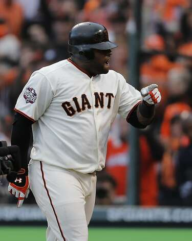 Giants' 3rd baseman Pablo Sandoval gestures after crossing the plate in the 1st inning in game 1 of the NLCS at AT&T Park on Sunday, Oct. 14, 2012 in San Francisco, Calif. Photo: Michael Macor, The Chronicle