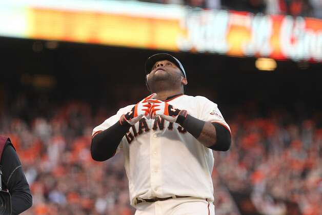 The Giants' Pablo Sandoval looks up as he crosses the plate in the first inning during Game 1 of the World Series at AT&T Park on Wednesday, Oct. 24, 2012 in San Francisco, Calif. Photo: Lance Iversen, The Chronicle