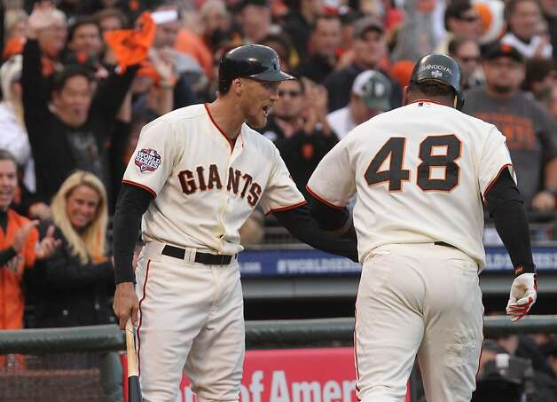 Giants' right fielder Hunter Pence greets Pablo Sandoval after Sandoval hit a homer in the first inning during Game 1 of the World Series at AT&T Park on Wednesday, Oct. 24, 2012 in San Francisco, Calif. Photo: Lance Iversen, The Chronicle