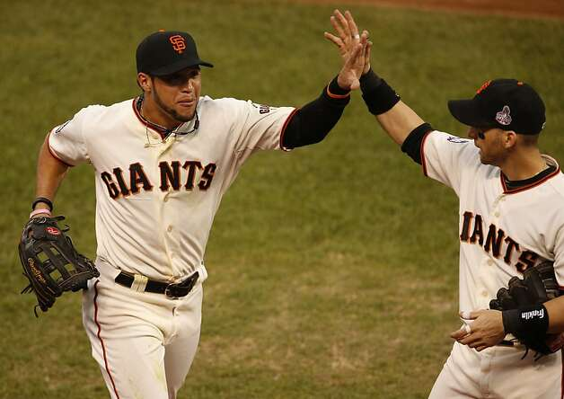 Giants' left fielder Gregor Blanco is greeted by Marco Scutaro heading back to the dugout in the 3rd inning during game 1 of the World Series at AT&T Park on Wednesday, Oct. 24, 2012 in San Francisco, Calif. Photo: Beck Diefenbach, Special To The Chronicle