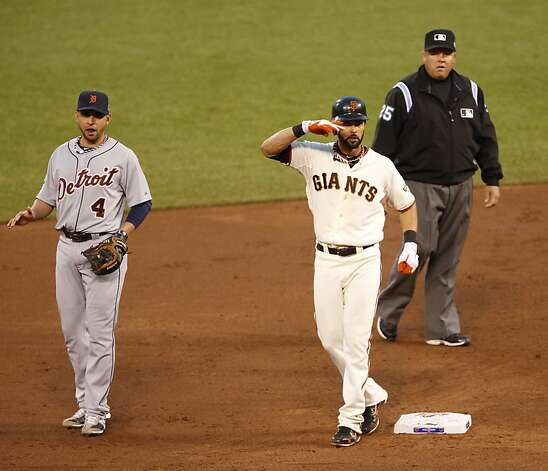 Giants' center fielder Angel Pagan salutes from second base during the third inning of Game 1 of the World Series at AT&T Park on Wednesday, Oct. 24, 2012 in San Francisco, Calif. Photo: Beck Diefenbach, Special To The Chronicle