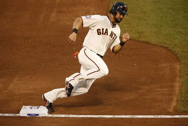 Giants' center fielder Angel Pagan rounds 3rd on his way home on a Marco Scutaro single in the 3rd inning during game 1 of the World Series at AT&T Park on Wednesday, Oct. 24, 2012 in San Francisco, Calif. Photo: Beck Diefenbach, Special To The Chronicle