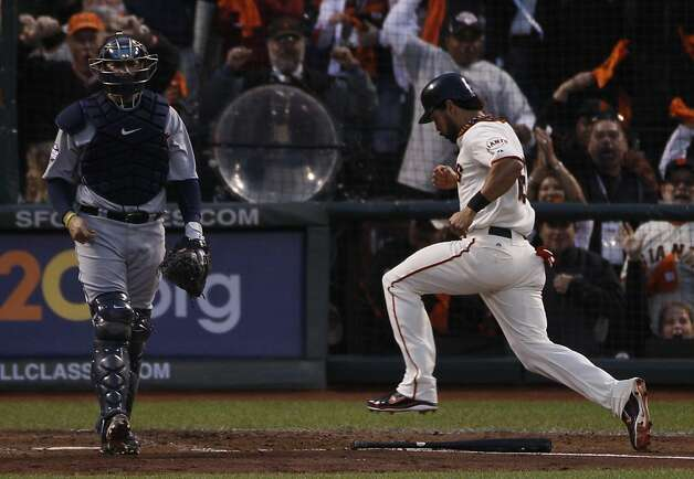 Giants' center fielder Angel Pagan heads home on a Marco Scutaro single in the 3rd inning during the World Series game 1 at AT&T Park in San Francisco, Calif., on Wednesday, Oct. 24, 2012. Photo: Carlos Avila Gonzalez, The Chronicle