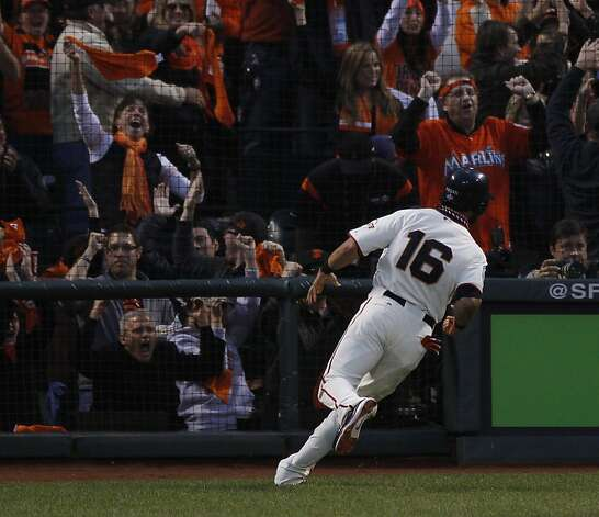 Fans cheer after Giants' center fielder Angel Pagan scored on a Marco Scutaro single in the 3rd inning during the World Series game 1 at AT&T Park in San Francisco, Calif., on Wednesday, Oct. 24, 2012. Photo: Carlos Avila Gonzalez, The Chronicle