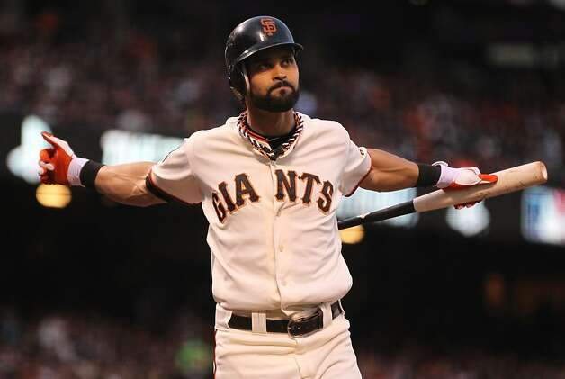 Giants' center fielder Angel Pagan stretches between pitches in the 3rd inning during game 1 of the World Series at AT&T Park on Wednesday, Oct. 24, 2012 in San Francisco, Calif. Photo: Lance Iversen, The Chronicle