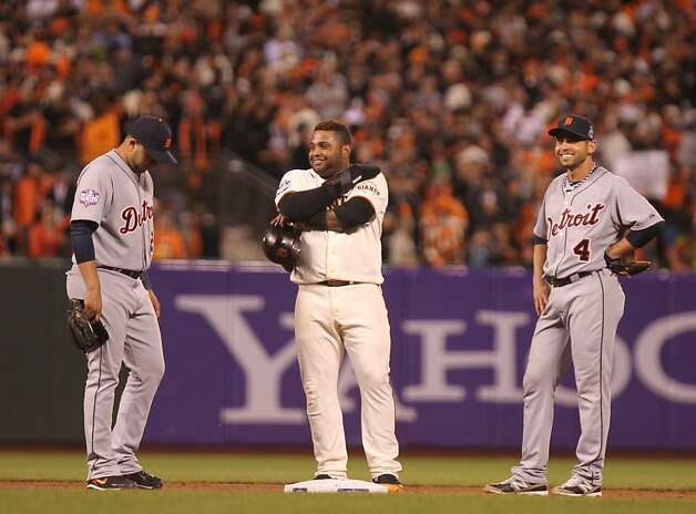 Giants' 3rd baseman Pablo Sandoval talks with Tigers' shortstop Jhonny Peralta and 2nd baseman Omar Infante during a break in the action in the 7th inning during game 1 of the World Series at AT&T Park on Wednesday, Oct. 24, 2012 in San Francisco, Calif. Photo: Lance Iversen, The Chronicle