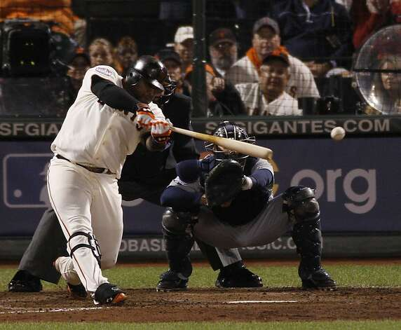 Giants' 3rd baseman Pablo Sandoval hits at single in the 7th to score Marco Scutaro during the World Series game 1 at AT&T Park in San Francisco, Calif., on Wednesday, Oct. 24, 2012. Photo: Carlos Avila Gonzalez, The Chronicle