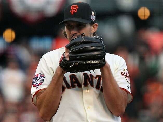 San Francisco Giants starting pitcher Barry Zito looks for a sign from his catcher Buster Posey during the first inning against the Detroit Tigers in game one of the World Series Wednesday, October 24, 2012 in San Francisco, California. Photo: Lance Iversen, The Chronicle