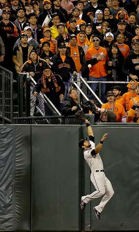 Giants' center fielder Angel Pagan can't quite reach the home run ball to center by the TIger's JHonny Peralta in the ninth innig, as the San Francisco Giants went on to beat the Detroit Tigers 8-3 to take game one of the World Series, on Wednesday Oct. 24, 2012 at AT&T Park, in  San Francisco, Calif. Photo: Michael Macor, The Chronicle