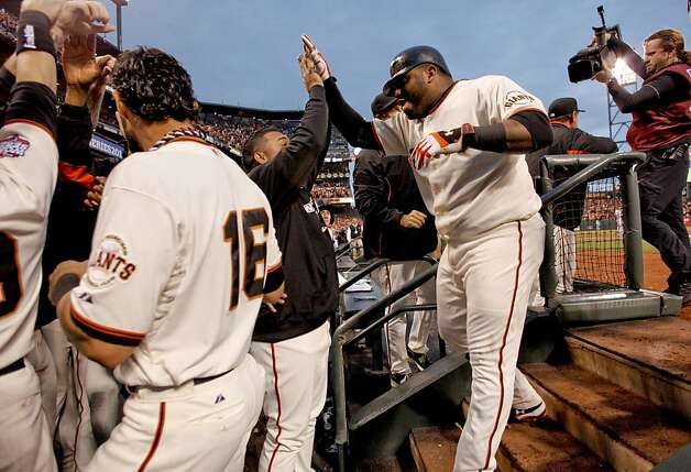 The Giants' celebrate the two run home run by Pablo Sandoval, (right)  in the third innnig, as the San Francisco Giants went on to beat the Detroit Tigers 8-3 to take game one of the World Series, on Wednesday Oct. 24, 2012 at AT&T Park, in  San Francisco, Calif. Photo: Michael Macor, The Chronicle