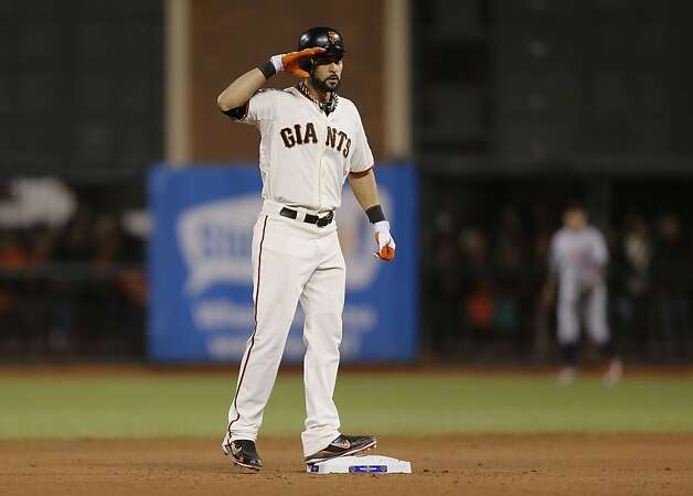 Giants' Angel Pagan gives his trademark salute after his double in the seventh inning, as the San Francisco Giants went on to beat the Detroit Tigers 8-3 to take game one of the World Series, on Wednesday Oct. 24, 2012 at AT&T Park, in  San Francisco, Calif. Photo: Michael Macor, The Chronicle