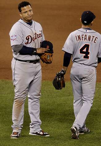 Miguel Cabrera (left) struck out to end the 8th inning and looked unhappy as he got his glove and hat from infielder Omar Infante. The San Francisco Giants defeated the Detroit Tigers 8-1 in the first game of the World Series in San Francisco, Calif. at AT&T park Wednesday October 24, 2012. Photo: Brant Ward, The Chronicle