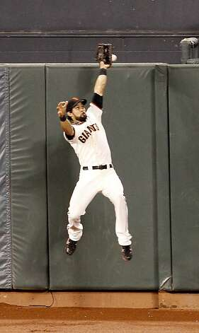 Angel Pagan could not come up with a home run by Jhonny Peralta late in the game. The San Francisco Giants defeated the Detroit Tigers 8-1 in the first game of the World Series in San Francisco, Calif. at AT&T park Wednesday October 24, 2012. Photo: Brant Ward, The Chronicle