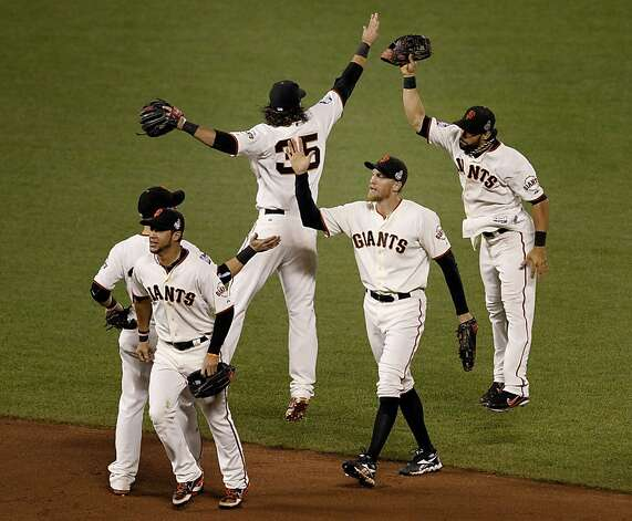 Giant players Gregor Blanco (left), Hunter Pence (center) and Angel Pagan (right) celebrated the Giants victory. The San Francisco Giants defeated the Detroit Tigers 8-3 in the first game of the World Series in San Francisco, Calif. at AT&T park Wednesday October 24, 2012. Photo: Brant Ward, The Chronicle