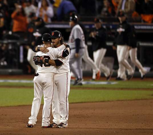 Brandon Crawford hugs Marco Scutaro after the final out is notched in Game 1 of the World Series. The San Francisco Giants defeated the Detroit Tigers in Game 1 of the World Series at AT&T Park on Wednesday, October 24, 2012, in San Francisco, Calif., The Giants defeated won 8-3. Photo: Carlos Avila Gonzalez, The Chronicle