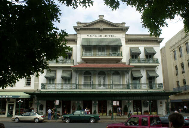 "Menger Hotel: Employees and guests have reported dozens of ghost sightings at the hotel. Among the better known spirits are Sallie White, an 1870s chambermaid who was shot by her husband because he believed she was cheating on him. Employees have seen a black woman believed to be Sallie ""in a uniform with an apron, a bandana wrapped around her hair and with her arms stretched out and full of fresh towels."" Also said to haunt the hotel is Capt. Richard King, founder of the famed King Ranch, who died at the Menger, in the room now known as the King Suite. A ghost dressed in a bolo tie and black hat, said to be King, has been spotted several times, and the elevator in the original building is said to regularly stop on the third floor, where the King Suite is located, without being punched. Employees also claim to have seen apparitions in the Menger Bar, and on the third floor, a ghost clad in a Davy Crockett jacket and ""The Lady in Blue,"" a woman clad in blue World War II-era dress knitting. Read More Photo: Bahram Mark Sobhani, For The Express-News / SAN ANTONIO EXPRESS-NEWS"