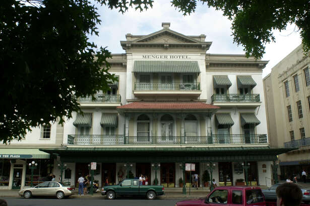"""Menger Hotel:  Employees and guests have reported dozens of ghost sightings at the hotel. Among the better known spirits are Sallie White, an 1870s chambermaid who was shot by her husband because he believed she was cheating on him. Employees have seen a black woman believed to be Sallie """"in a uniform with an apron, a bandana wrapped around her hair and with her arms stretched out and full of fresh towels."""" Also said to haunt the hotel is Capt. Richard King, founder of the famed King Ranch, who died at the Menger, in the room now known as the King Suite. A ghost dressed in a bolo tie and black hat, said to be King, has been spotted several times, and the elevator in the original building is said to regularly stop on the third floor, where the King Suite is located, without being punched. Employees also claim to have seen apparitions in the Menger Bar, and on the third floor, a ghost clad in a Davy Crockett jacket and """"The Lady in Blue,"""" a woman clad in blue World War II-era dress knitting.   Read More"""