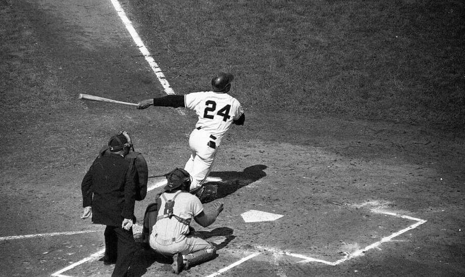 Oct. 4, 1962: Willie Mays swings away in the first game of the World Series. The Giants were relatively new to the West Coast, but they had swagger. So did their fans, as you'll see ... Photo: Bob Campbell, The Chronicle / ONLINE_YES