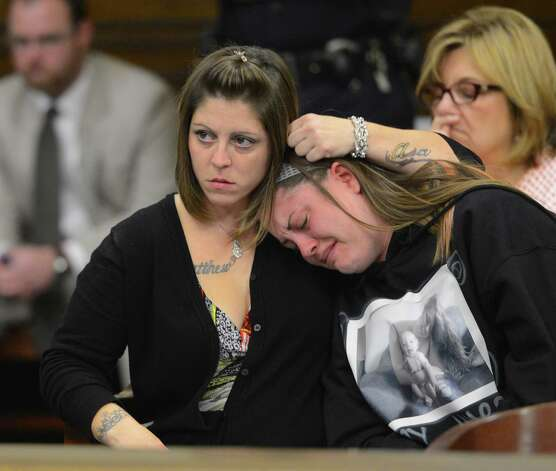 Shannon Pozniakas, left, comforts her sister Kayla Sticklemyer as Robert Hayden was sentenced for killing Pozniakas' child Avery Cahn while  babysitting the child. Hayden's sentence was imposed by Rensselaer County Judge Andrew Ceresia in the Rensselaer County Courthouse in Troy, N.Y. Oct 25, 2012.  (Skip Dickstein/Times Union) Photo: SKIP DICKSTEIN / 00019838A