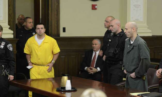 Matthew Cahn, left, father of the deceased child enters the courtroom to give a victim impact statement as defendant  Robert Hayden watches. Hayden was  sentenced for killing Cahn's child Avery Cahn while babysitting the child. Hayden's sentence was imposed by Rensselaer County Judge Andrew Ceresia in the Rensselaer County Courthouse in Troy, N.Y. Oct 25, 2012.  (Skip Dickstein/Times Union) Photo: SKIP DICKSTEIN / 00019838A