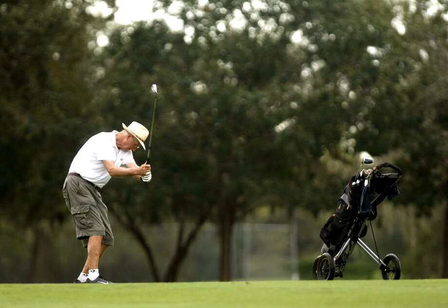 Take a swing at playing golf at the Hermann Park Golf Course. Photo: Johnny Hanson, .