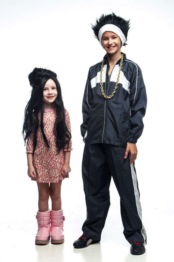 """Hazel Britton-Dansby as Snookie and North Odell as Pauly D from """"Jersey Shore"""", Monday, Oct. 22, 2012, in Houston. (Michael Paulsen / Houston Chronicle ) Photo: Michael Paulsen, Houston Chronicle / © 2012 Houston Chronicle"""