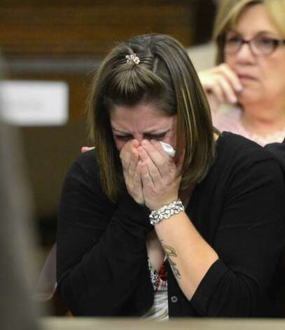 Shannon Pazniakas is overcome by emotion as her mother gives her victim impact statement during Robert Hayden's sentencing for killing Pazniakas' child Avery Cahn while babysitting the child. Hayden's sentence was imposed by Rensselaer County Judge Andrew Ceresia in the Rensselaer County Courthouse in Troy, N.Y. Oct 25, 2012.  (Skip Dickstein/Times Union) Photo: SKIP DICKSTEIN / 00019838A