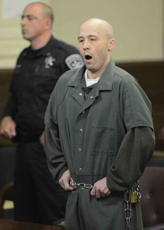 Defendant Robert Hayden yawns during his sentencing procedure. Hayden was  sentenced for killing infant Avery Cahn while babysitting the child. Hayden's sentence was imposed by Rensselaer County Judge Andrew Ceresia in the Rensselaer County Courthouse in Troy, N.Y. Oct 25, 2012.  (Skip Dickstein/Times Union) Photo: SKIP DICKSTEIN / 00019838A