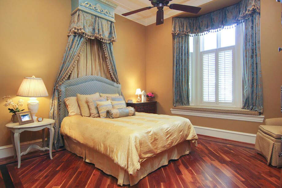 This bedroom has a bay window and rich hardwood floors. Photo: Better Homes And Gardens Real Estate