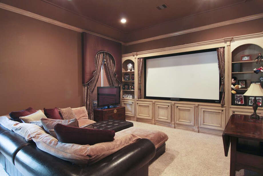 The home theater is perfect for entertaining. Photo: Better Homes And Gardens Real Estate