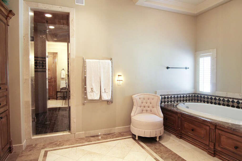 The master bathroom has marble floors and a large soaking tub. Photo: Better Homes And Gardens Real Estate