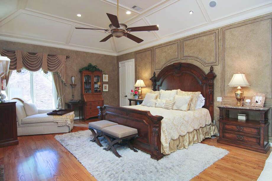 The master bedroom has a vaulted ceiling, textured walls and a fireplace. Photo: Better Homes And Gardens Real Estate