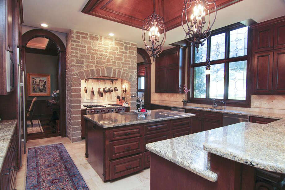 The gourmet kitchen includes lots of counter space, stainless steel appliances and solid oak cabinets. Photo: Better Homes And Gardens Real Estate